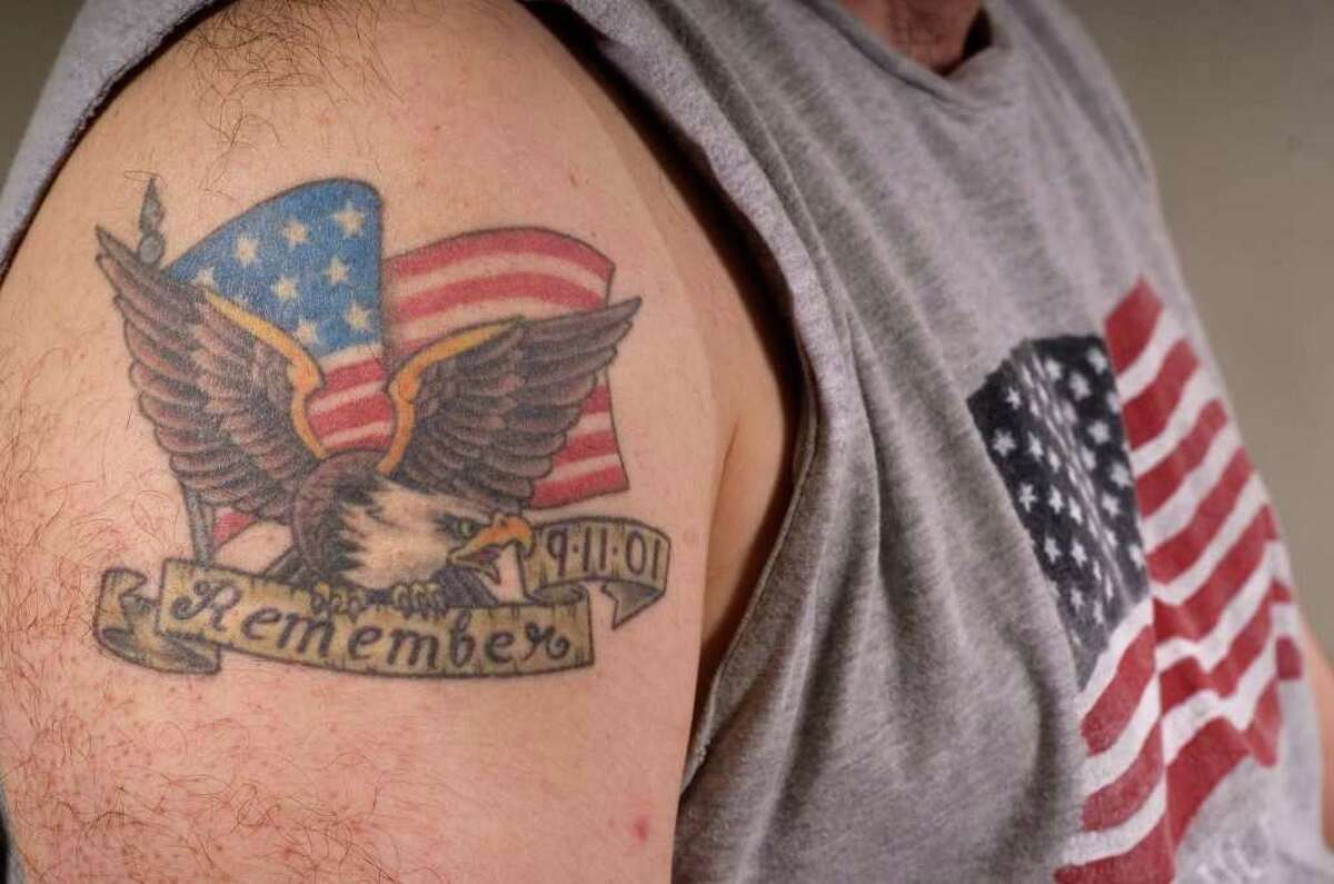 Brookfield resident Matt Grimes, 32, worked at AIG, a few blocks away from the Twin Towers when they were attacked on Sept. 11, 2001, and had a tattoo made to commemorate the attacks.