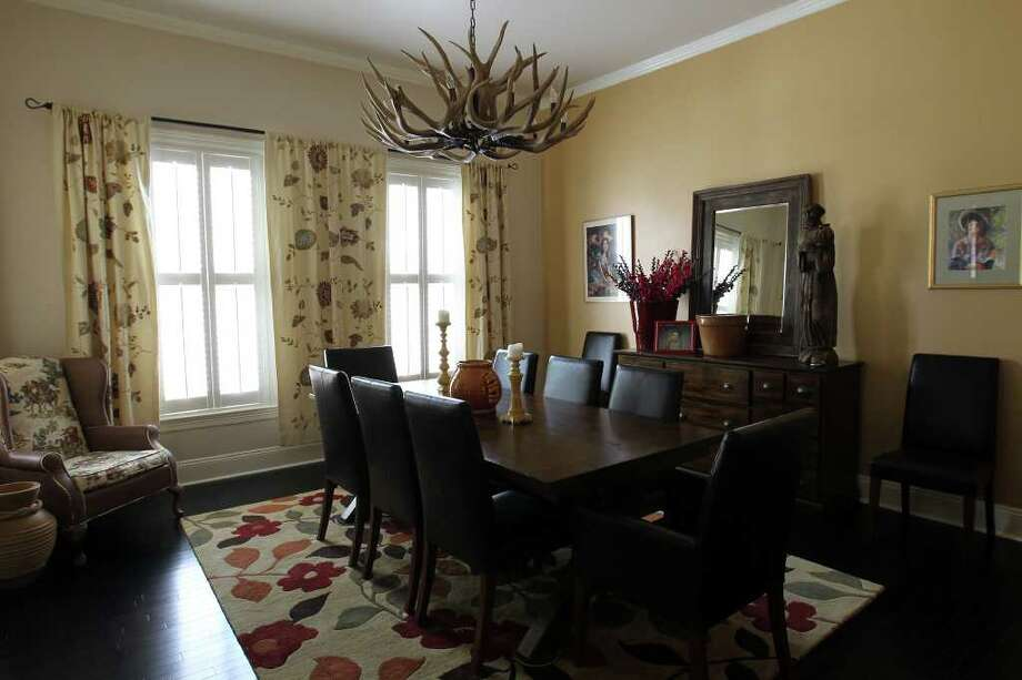 The mahogany dining table expands to seat 12. Christine and Rene Salenga moved the antler chandelier from their other home in Katy to this home near King William. Photo: Jennifer Whitney, Special To The Express-News / special to the Express-News