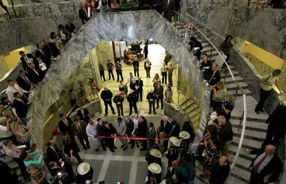 The recent ribbon-cutting drew a crowd under the refurbished rotunda inside the 1910 Harris County courthouse, 301 Fannin. (Melissa Phillip/Chronicle) Photo: Melissa Phillip, Staff / © 2011 Houston Chronicle