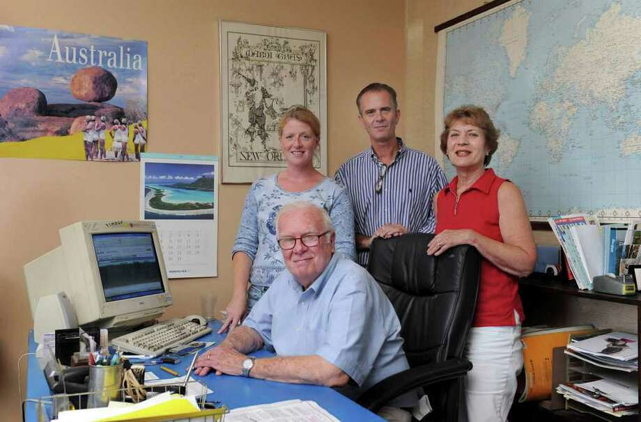 The staff of the Holton Travel Inc. on White Street in Danbury: Jerry Holton, founder, seated. From left, travel consultant Laura Luizzi, Tom Holton and Barbara Holton. Photo taken Wednesday, August 31, 2011. Photo: Carol Kaliff