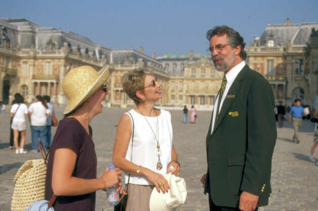A Tauck guide sharing stories with tourists about Versailles, France Photo: Contributed Photo