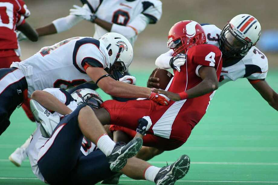 Viking quarterback Eric Johnson (4) carries the ball in the first quarter as the Seven Lakes Spartans face the Dulles Vikings in nondistrict action Friday night September 2, 2011 at Mercer Stadium in Sugarland.  Nathan Lindstrom Photography  ©2010 Nathan Lindstrom Photo: Nathan Lindstrom, Freelance / ©2011 Nathan Lindstrom