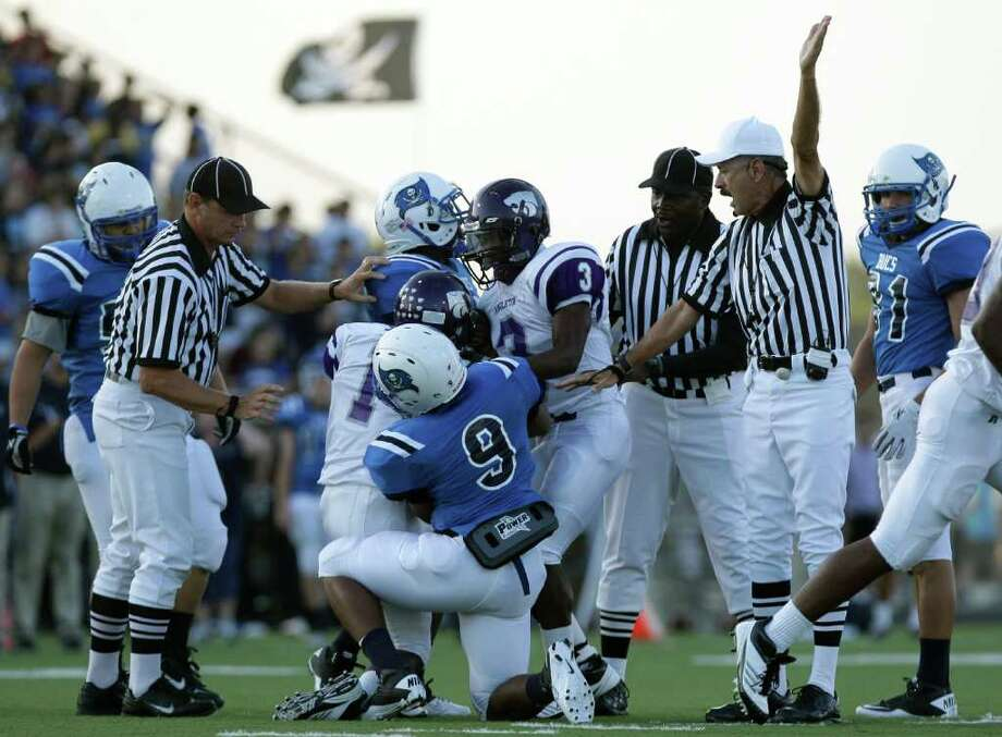 A referee signals that Angleton's Gerard Scott (1) recovered a Brazoswood fumble in the first quarter. Photo: Thomas B. Shea / Special To The