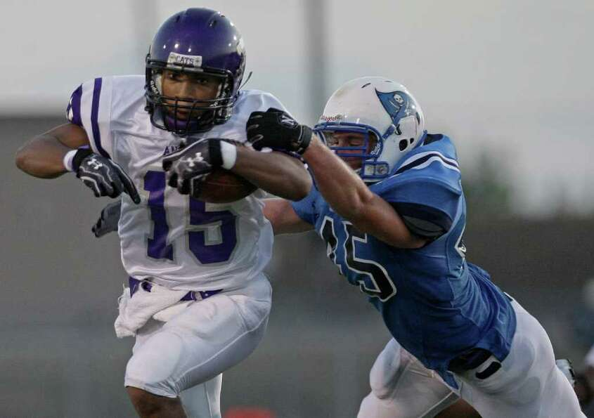Angleton fullback Richard Cooper (15) is tackled by Brazoswood linebacker Nick Wooten.