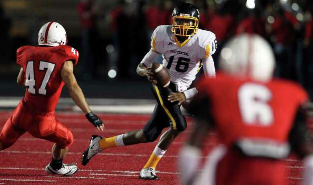 SPORTS  Hornet quarterback Jeremy Jones gets chased out of the backfield by Curtis Klinge as Canyon plays East Central  at Canyon High School football field in New Braunfels  on September 2, 2011.    Tom Reel/Staff Photo: TOM REEL, Express-News / © 2011 San Antonio Express-News