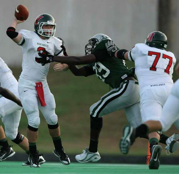 The Woodlands' Lance Miles (3) avoids a sack by Hightower's TJ Williams as Miles' teammate Jonathan