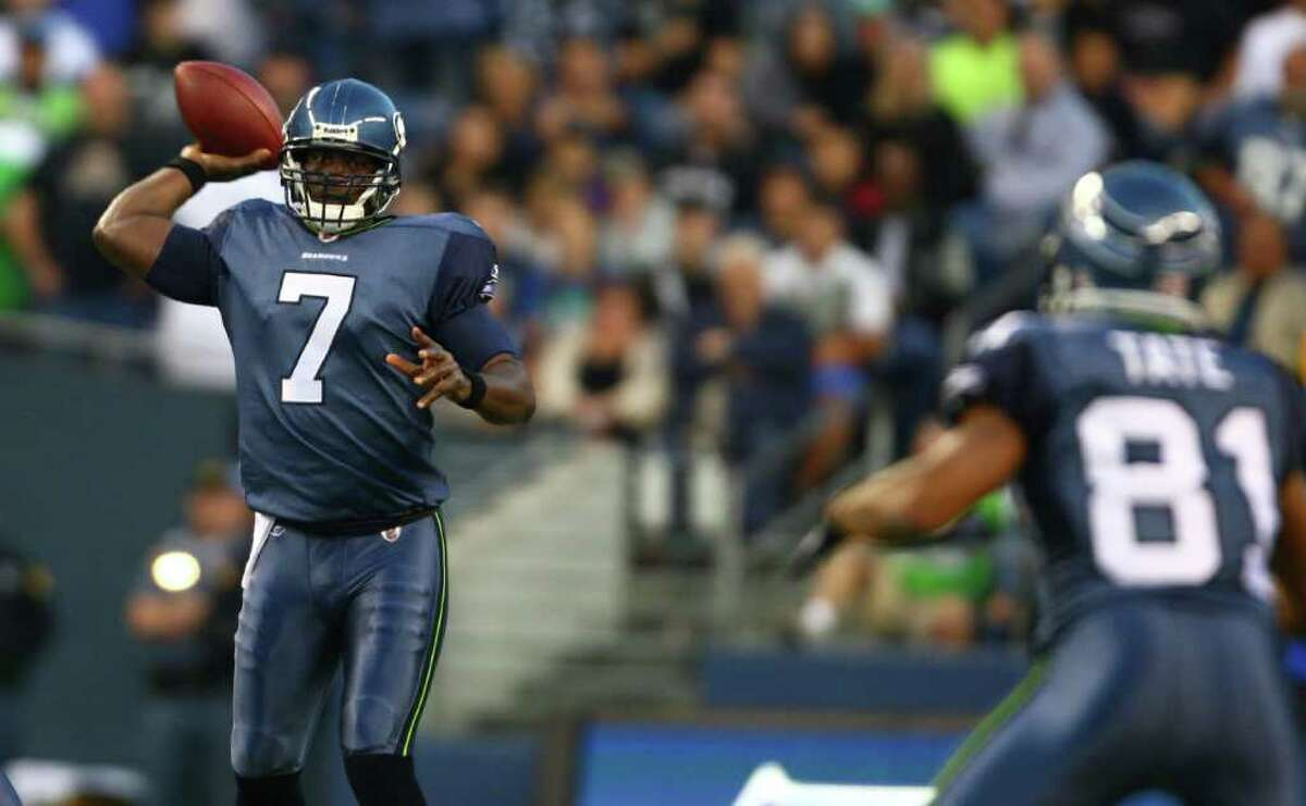 Seattle Seahawks quarterback Tarvaris Jackson throws to Golden Tate against the Oakland Raiders during the first half of a preseason game at CenturyLink Field in Seattle. Jackson completed five of seven passes for 88 yards, with an interception. The Hawks defeated the Raiders 20-3.