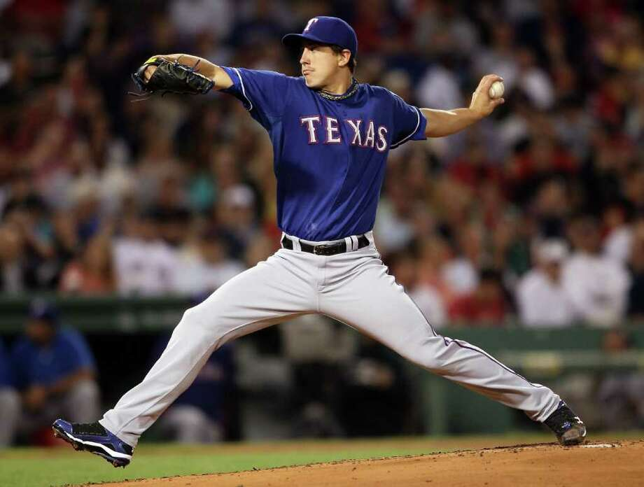 ELSA: GETTY IMAGES CRUISE CONTROL: Rangers starter Derek Holland turned in a dominant performance in shutting down the Red Sox on Friday. Photo: Elsa, Staff / 2011 Getty Images