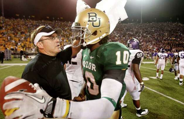 Baylor quarterback Robert Griffin III (10) and TCU head coach Gary Patterson talks after their NCAA college football game in Waco, Texas, Friday, Sept. 2, 2011. Baylor won 50-48. Photo: LM Otero