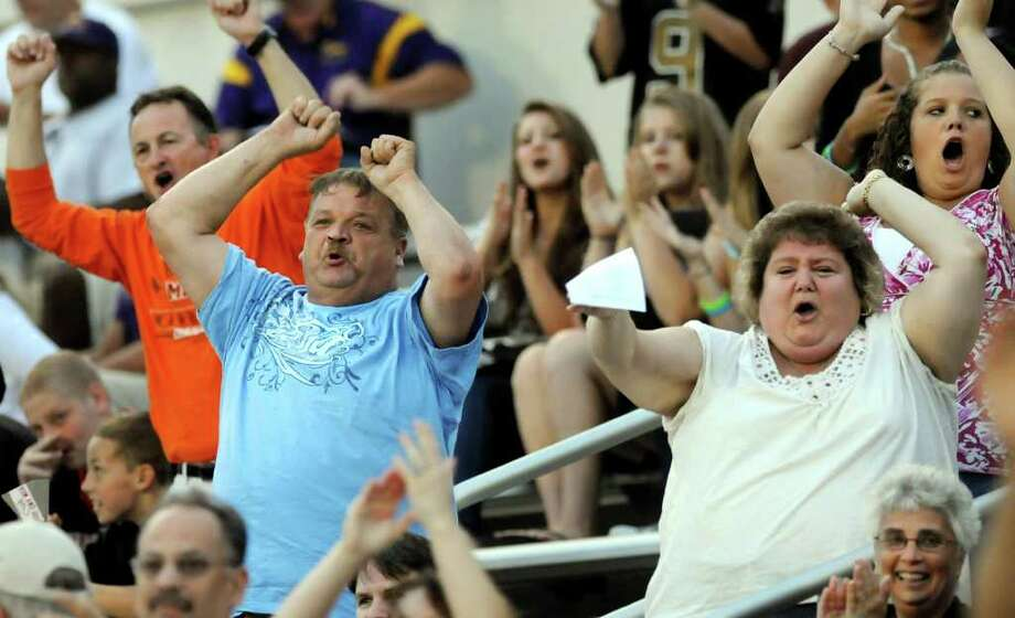 Mohonasen fans cheer after a touchdown during their team's football game against Green Tech on Friday, Sept. 2, 2011, at Union College in Schenectady, N.Y. (Cindy Schultz / Times Union) Photo: Cindy Schultz