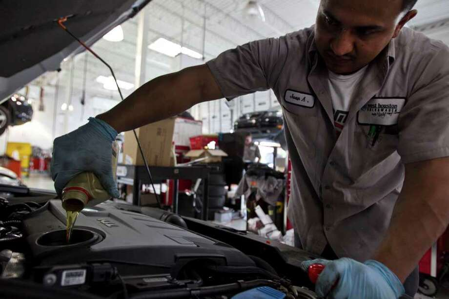 James Nielsen Photos : Chronicle ONE SOLUTION?: Service technician Juan Argueta performs the 10,000-mile maintenance on a diesel Jetta at the West Houston Volkswagen dealership. Diesel powers about 3 percent of U.S. passenger vehicles, said Allen Schaeffer of the Diesel Technology Forum, a nonprofit industry group. Photo: James Nielsen, Staff / © 2011 Houston Chronicle