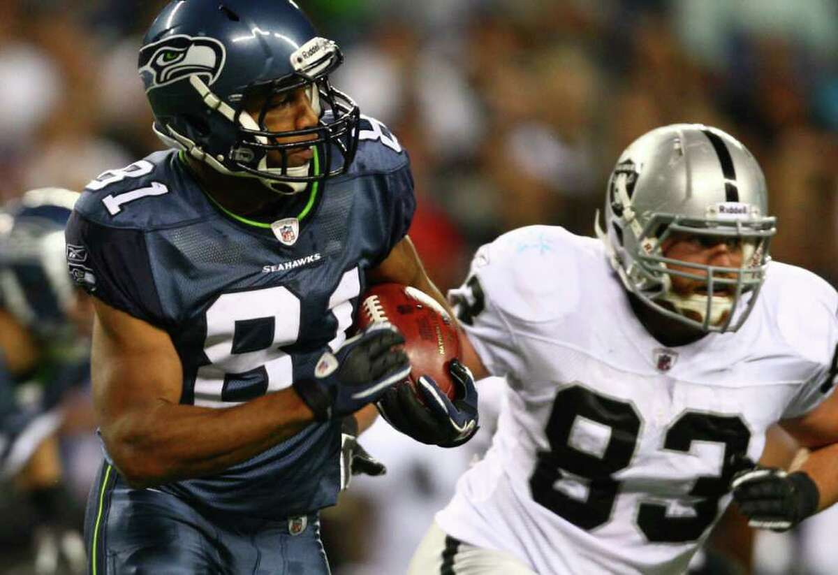 Seattle Seahawks player Golden Tate breaks away from Oakland Raiders player Brandon Myers (83) during first half action on Friday, September 2, 2011 at CenturyLink Field in Seattle. Tate caught five passes for 79 yards. The Hawks defeated the Raiders 20-3.