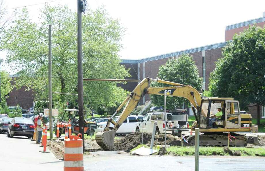 Construction work for the Greenwich High School music instructional space and auditorium project continues Aug. 24, 2011. Toxins unearthed during the project have closed all athletic fields adjacent to the construction. Photo: Bob Luckey / Greenwich Time