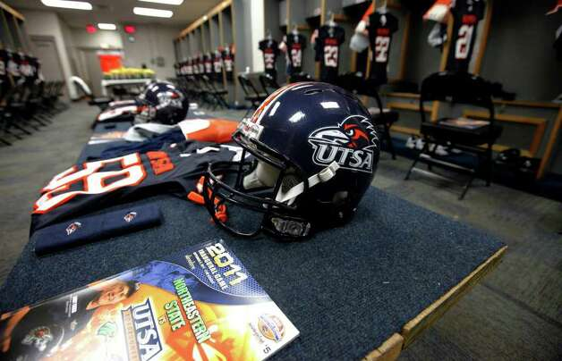 Equipment is laid out in the locker room prior to the entrance of UTSA football players at the Alamodome on Saturday, Sept. 3, 2011. UTSA will be playing Northeastern State in their inaugural NCAA football game. Kin Man Hui/kmhui@express-news.net Photo: Kin Man Hui, Express-News / SAN ANTONIO EXPRESS-NEWS (NFS)