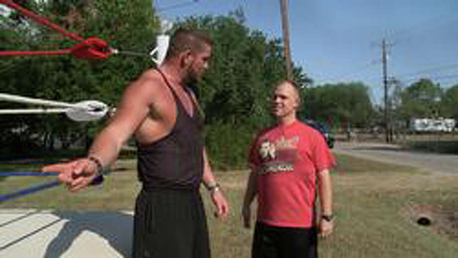 """Pro wrestler Matt Maorgan,a Fairfield native, left, coaches Chris Guerra, a 28-year-old police officer from Texas, in the cable television show, """"CMT Made."""" Photo: CMT / Fairfield Citizen contributed"""