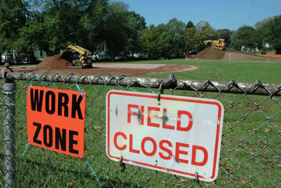 Work has started on the Fairfield American Little League $165,000 project to reconfigure the two existing fields at Gould Manor Park in Fairfield, Conn. Workers were on the site on Friday Sept. 2, 2011. The project will include chain-link permanent fences, up to 80 feet long and 10 feet high, between the two fields as well as temporary 4-foot-high home-run fences made of vinyl fabric to be used during Little League seasons. Photo: Cathy Zuraw / Connecticut Post