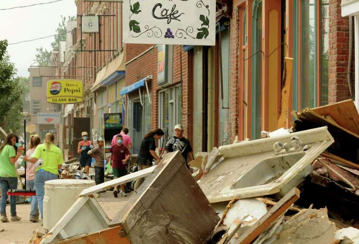 Click through the slideshow to see photos of the Capital Region after Tropical Storm Irene in 2011. Downtown businesses on Main Street continue the decontamination and clean up process in the Town of Schoharie NY Saturday Sept.3, 2011. ( Michael P. Farrell/Times Union)
