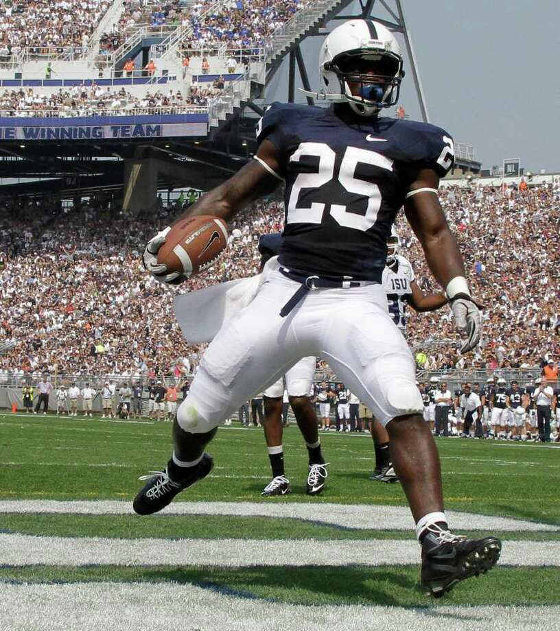 Penn State running back Silas Redd (25) celebrates after scoring a touchdown against Indiana State during the first quarter of Saturday's 41-7 win by the Nittany Lions. Redd rushed for 104 yards and two touchdowns. Photo: Gene J. Puskar/Associated Press / AP