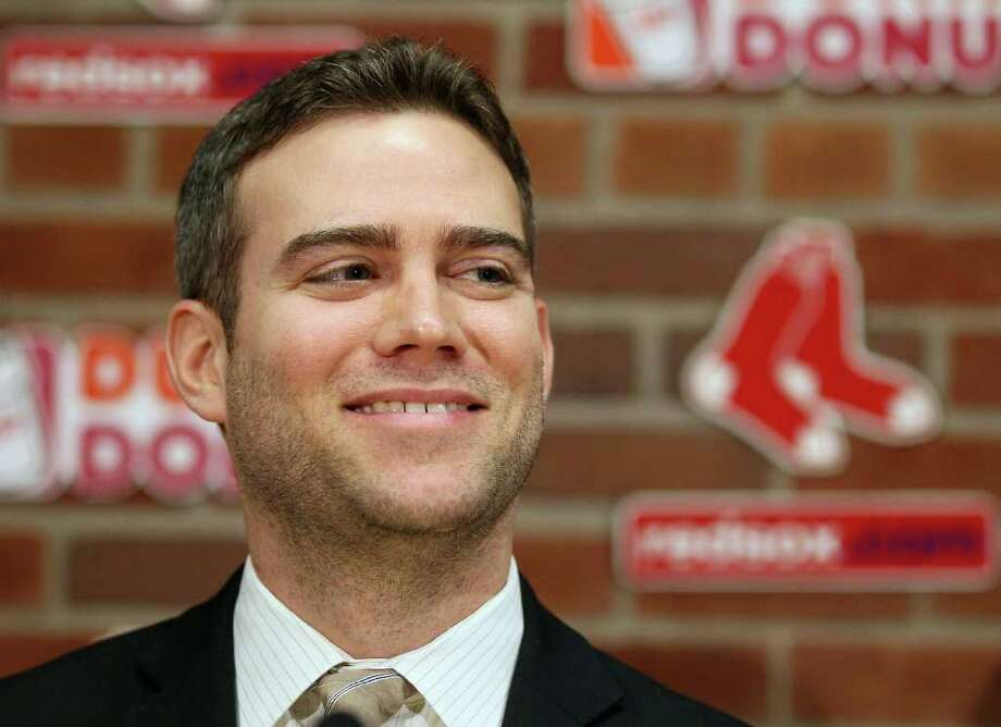BOSTON, MA - DECEMBER 11:  Theo Epstein, general manager of the Boston Red Sox, answers questions about Carl Crawford during a press conference on December 11,  2010 at the Fenway Park in Boston, Massachusetts.  (Photo by Elsa/Getty Images) Photo: Elsa, Getty Images / 2010 Getty Images