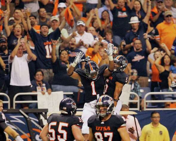 UTSA's Kam Jones, left, and Brandon Armstrong leap to celebrate a touchdown during the first half of an NCAA college football game against Northeastern State, Saturday, Sept. 3, 2011, at the Alamodome in San Antonio. (AP Photo/Darren Abate) Photo: Express-News