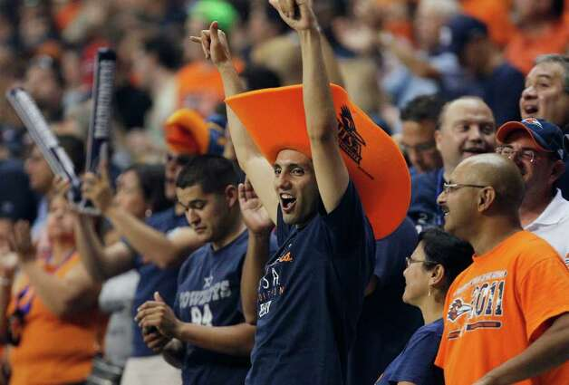 UTSA fans celebrate a touchdown during the first half of an NCAA college football game against Northeastern State, Saturday, Sept. 3, 2011, at the Alamodome in San Antonio. (AP Photo/Darren Abate) Photo: Express-News