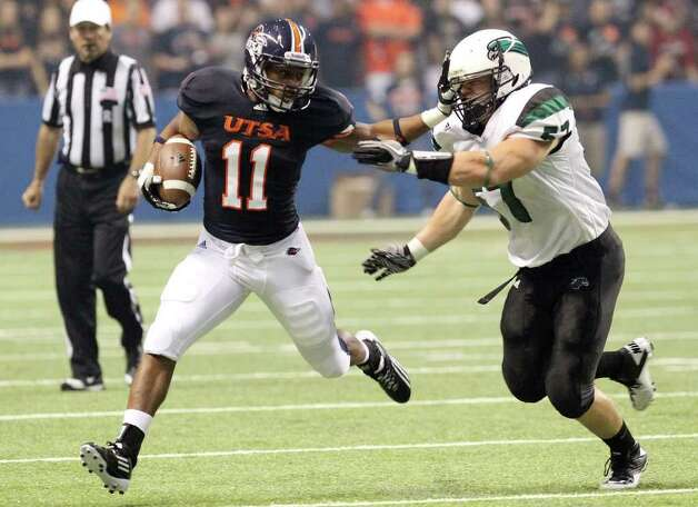 UTSA's David Glasco, II (11) fends off Northeastern State's Jack Gray (57) on play in the first half at the Alamodome on Saturday, Sept. 3, 2011. Kin Man Hui/kmhui@express-news.net Photo: Kin Man Hui, Express-News / SAN ANTONIO EXPRESS-NEWS (NFS)