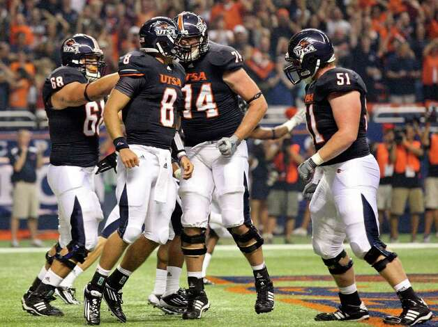 FOR SPORTS - UTSA's Eric Soza (center) celebrates with teammates after scoring the first touchdown of the game against Northeastern State during first half action Saturday Sept. 3, 2011 at the Alamodome. Photo: EDWARD A. ORNELAS, Express-News / SAN ANTONIO EXPRESS-NEWS (NFS)