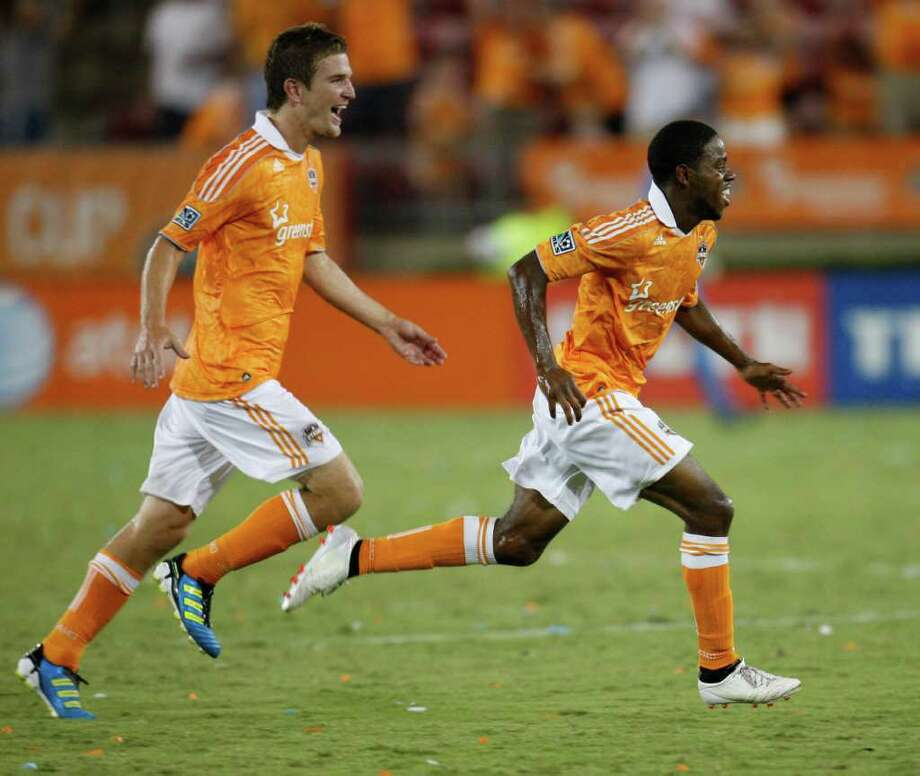 HOUSTON, TX - AUGUST 20: Alex Dixon #19 (R) of the Houston Dynamo runs off the field after scoring the game-winning goal against Real Salt Lake in the ninetieth minute as teammate Bobby Boswell #32 follows at Robertson Stadium on August 20, 2011 in Houston, Texas. The Dynamo beat Real Salt Lake 3-2. Photo: Eric Christian Smith, Getty / 2011 Getty Images