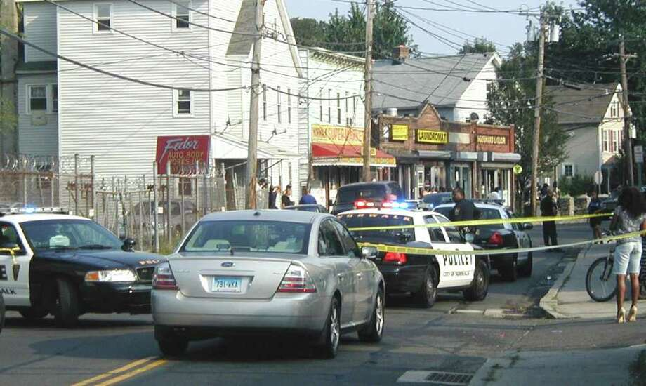 Police respond to the scene if a shootout on Woodward Avenue in Norwalk Saturday afternoon. Photo: Contributed Photo