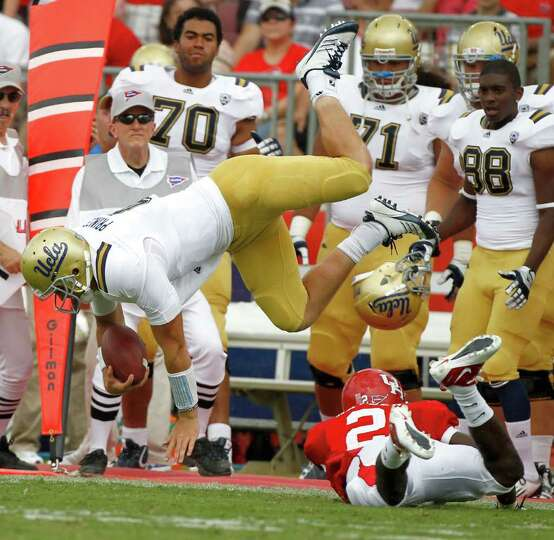 UH defensive back D.J. Hayden knocks over UCLA quarterback Kevin Prince. Prince was injured on th