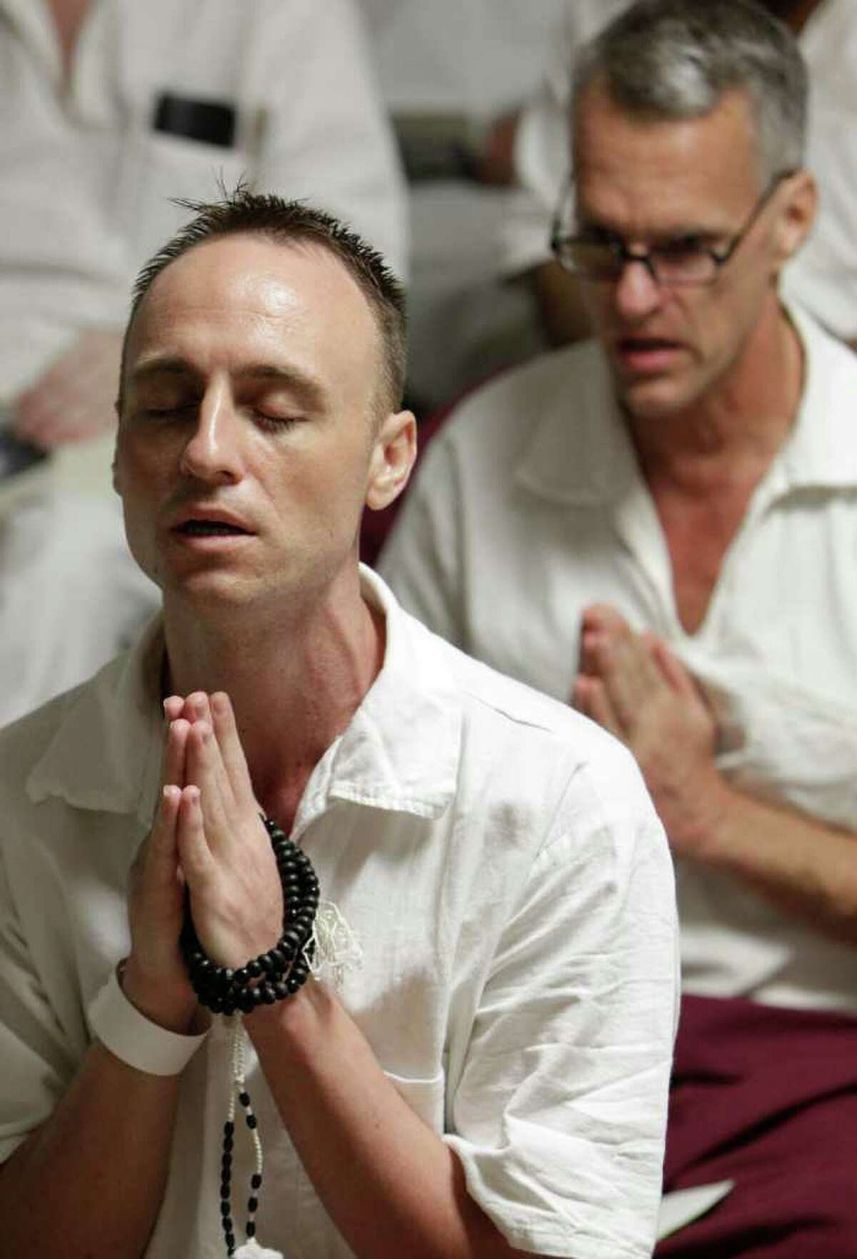Conley Stagg, front, meditates during a class taught by Buddhist Terry Conrad at the Texas Department of Criminal Justice MarkStiles Unit in Beaumont.