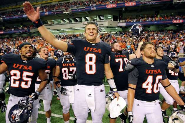 UTSA's Mark Waters  (from left) and teammates UTSA's Eric Soza and UTSA's William Ritter celebrate late in the game against Northeastern State Saturday Sept. 3, 2011 at the Alamodome. UTSA won 31-3. Photo: EDWARD A. ORNELAS, Express-News / SAN ANTONIO EXPRESS-NEWS (NFS)