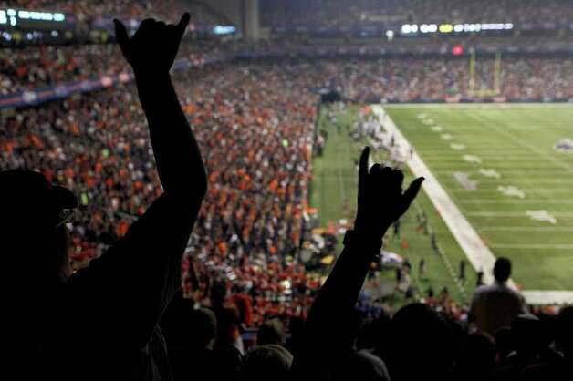 Tina Brewster, left, and Star Lowe, right, cheer during UTSA's inaugural football game against Northeastern State at the Alamodome on Saturday, Sept. 3, 2011. LISA KRANTZ/lkrantz@express-news.net Photo: LISA KRANTZ, Express-News / SAN ANTONIO EXPRESS-NEWS