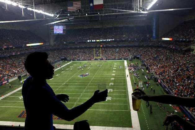 UTSA Alumni Adam Fein toasts a friend during UTSA's inaugural football game against Northeastern State at the Alamodome on Saturday, Sept. 3, 2011. LISA KRANTZ/lkrantz@express-news.net Photo: LISA KRANTZ, Express-News / SAN ANTONIO EXPRESS-NEWS