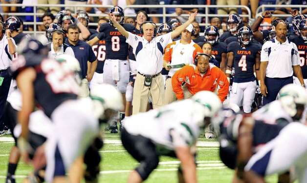 UTSA's head coach Larry Coker (center) watches second half action from the sidelines against Northeastern State during Saturday Sept. 3, 2011 at the Alamodome. UTSA won 31-3. Photo: EDWARD A. ORNELAS, Express-News / SAN ANTONIO EXPRESS-NEWS (NFS)