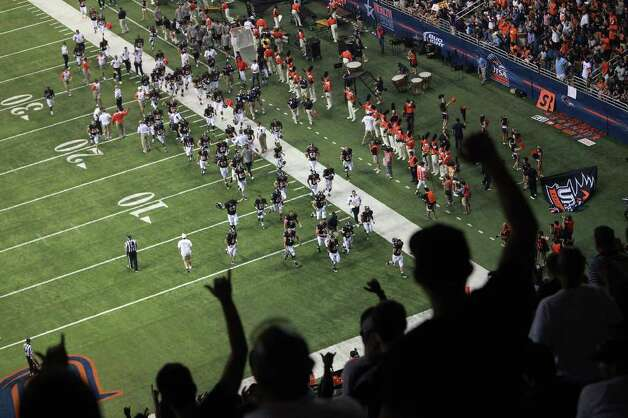 Fans cheer as the team heads off the field for halftime during UTSA's inaugural football game against Northeastern State at the Alamodome on Saturday, Sept. 3, 2011. LISA KRANTZ/lkrantz@express-news.net Photo: LISA KRANTZ, Express-News / SAN ANTONIO EXPRESS-NEWS