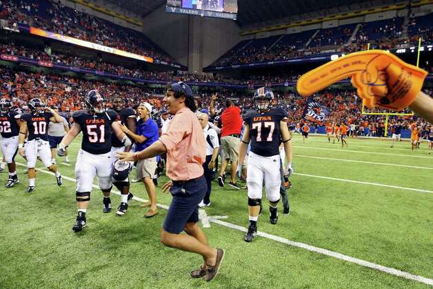 UTSA fans run onto the field after the game with Northeastern State Saturday Sept. 3, 2011 at the Alamodome. UTSA won 31-3. Photo: EDWARD A. ORNELAS, Express-News / SAN ANTONIO EXPRESS-NEWS (NFS)