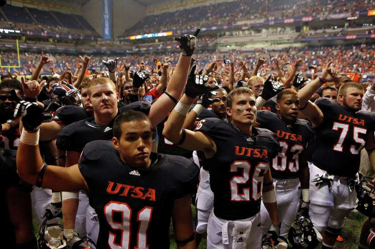 UTSA players stand by as the band plays the Alma Mater at the conclusion of UTSA's inaugural football game against Northeastern State at the Alamodome on Saturday, Sept. 3, 2011. LISA KRANTZ/lkrantz@express-news.net