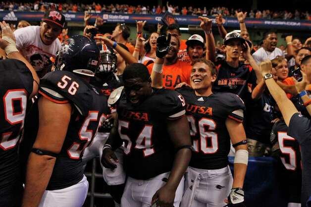 UTSA players celebrate with fans at the conclusion of UTSA's inaugural football game against Northeastern State at the Alamodome on Saturday, Sept. 3, 2011. LISA KRANTZ/lkrantz@express-news.net Photo: LISA KRANTZ, Express-News / SAN ANTONIO EXPRESS-NEWS