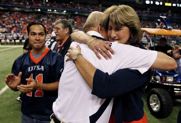 UTSA's head coach Larry Coker hugs UTSA's athletic director Lynn Hickey before the game with Northeastern State Saturday Sept. 3, 2011 at the Alamodome as Mayor Julian Castro looks on. Photo: EDWARD A. ORNELAS, Express-News / SAN ANTONIO EXPRESS-NEWS (NFS)
