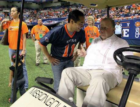 "Mayor Julian Castro (center) talks to businessman B.J. ""Red"" McCombs prior to the start of UTSA's inaugural football game against Northeastern State on Saturday, Sept. 3, 2011. Kin Man Hui/kmhui@express-news.net Photo: Kin Man Hui, Express-News / SAN ANTONIO EXPRESS-NEWS (NFS)"