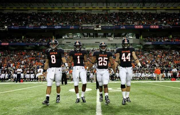 UTSA's Eric Soza (from left) UTSA's  Kam Jones, UTSA's  Mark Waters,  and UTSA's Steven Kurfehs walk to the center of the field for the coin toss with Northeastern State Saturday Sept. 3, 2011 at the Alamodome. Photo: EDWARD A. ORNELAS, Express-News / SAN ANTONIO EXPRESS-NEWS (NFS)