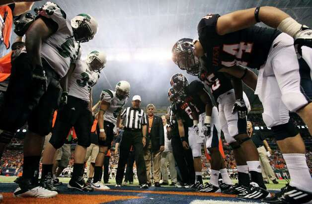 Northeastern State players and UTSA players check the coin after the toss before the game Saturday Sept. 3, 2011 at the Alamodome. Photo: EDWARD A. ORNELAS, Express-News / SAN ANTONIO EXPRESS-NEWS (NFS)