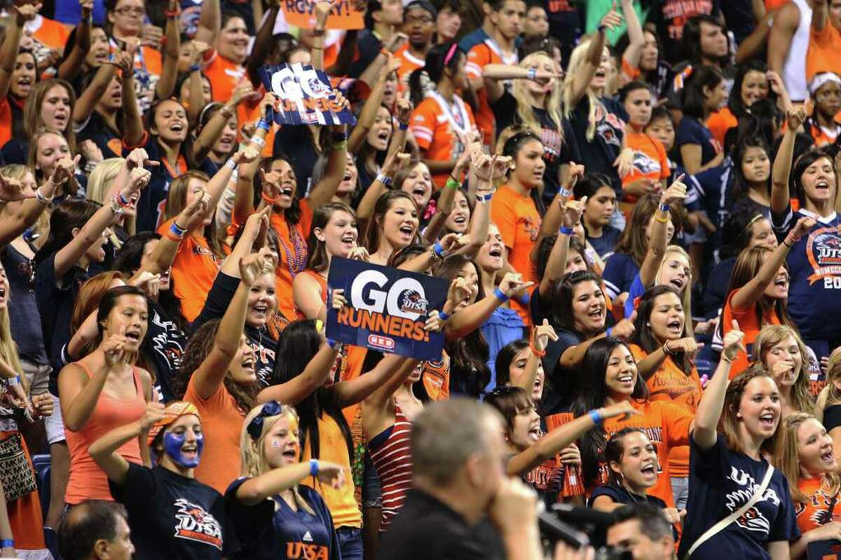 UTSA students cheer on their football team against Northeastern State at the Alamodome on Saturday, Sept. 3, 2011. UTSA defeated Northeastern State, 31-3. A total of 56,743 fans turned out for the game. Kin Man Hui/kmhui@express-news.net