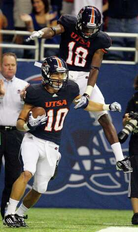 UTSA's Jake Wanamaker (bottom) celebrates with teammate UTSA's Kenny Harrison after scoring a touchdown against Northeastern State during first half action Saturday Sept. 3, 2011 at the Alamodome. Photo: EDWARD A. ORNELAS, Express-News / SAN ANTONIO EXPRESS-NEWS (NFS)