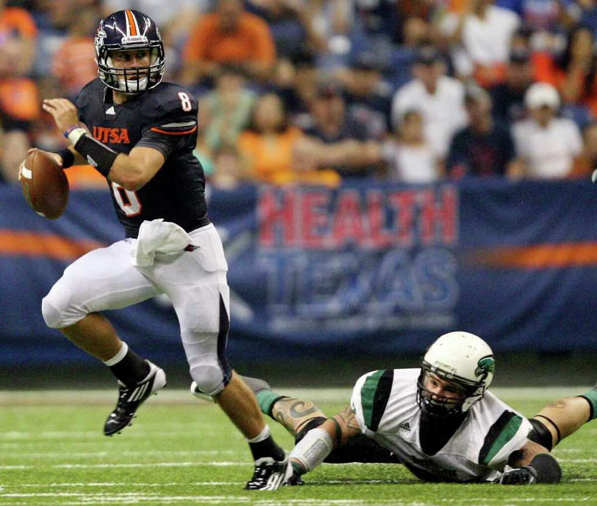 UTSA's Eric Soza looks for room around Northeastern State's Travis Boswell during first half action Saturday Sept. 3, 2011 at the Alamodome.