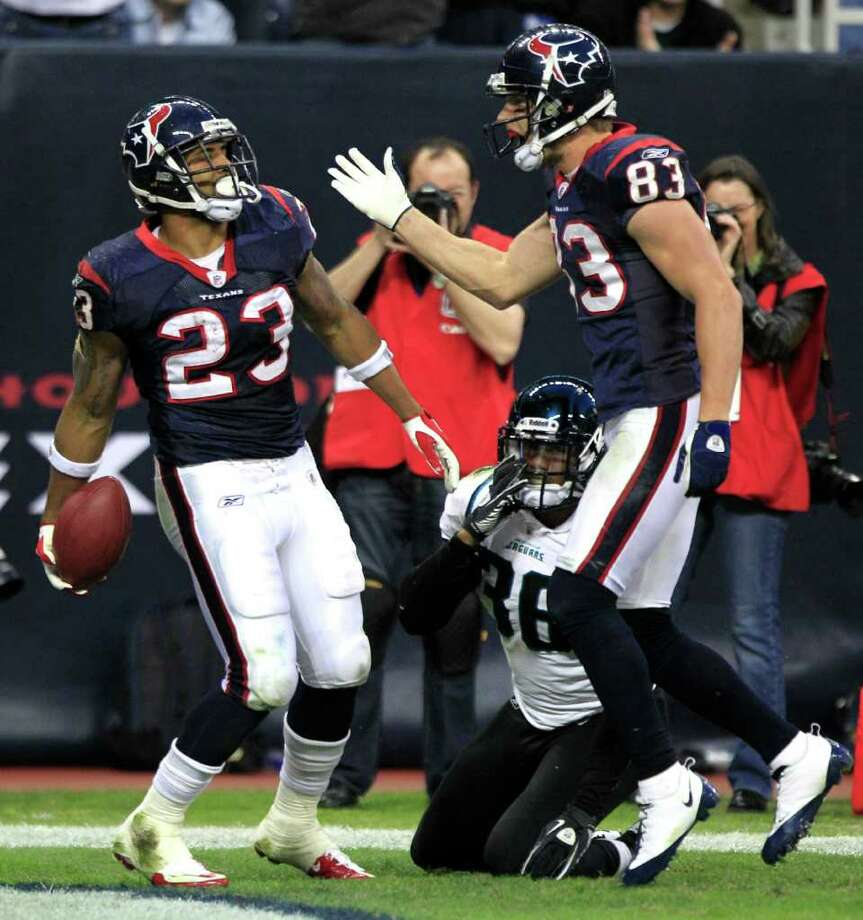 Houston Texans running back Arian Foster (23) and Houston Texans wide receiver Kevin Walter (83) celebrate Foster's 35-yard touchdown run against the Jacksonville Jaguars during the fourth quarter of an NFL football game at Reliant Stadium Sunday, Jan. 2, 2011, in Houston. The Texans beat the Jaguars 34-17, finishing the season 6-10. ( Brett Coomer / Houston Chronicle ) Photo: Brett Coomer, Staff / Houston Chronicle