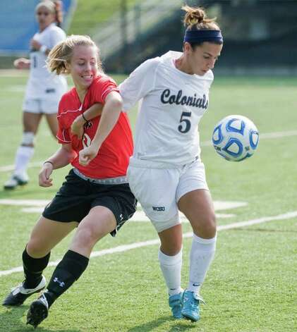 Catholic University's Ellen Jansen pushes Colonials Lauren Francisco during a game at WestConn. Saturday, Sept. 3, 2011 Photo: Scott Mullin / The News-Times Freelance