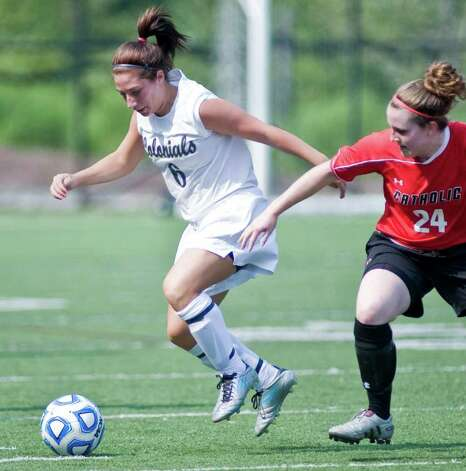 Colonials Lisa Sanzari tries to get away from Catholic University's Caitlin Conroy during a game at WestConn. Saturday, Sept. 3, 2011 Photo: Scott Mullin / The News-Times Freelance