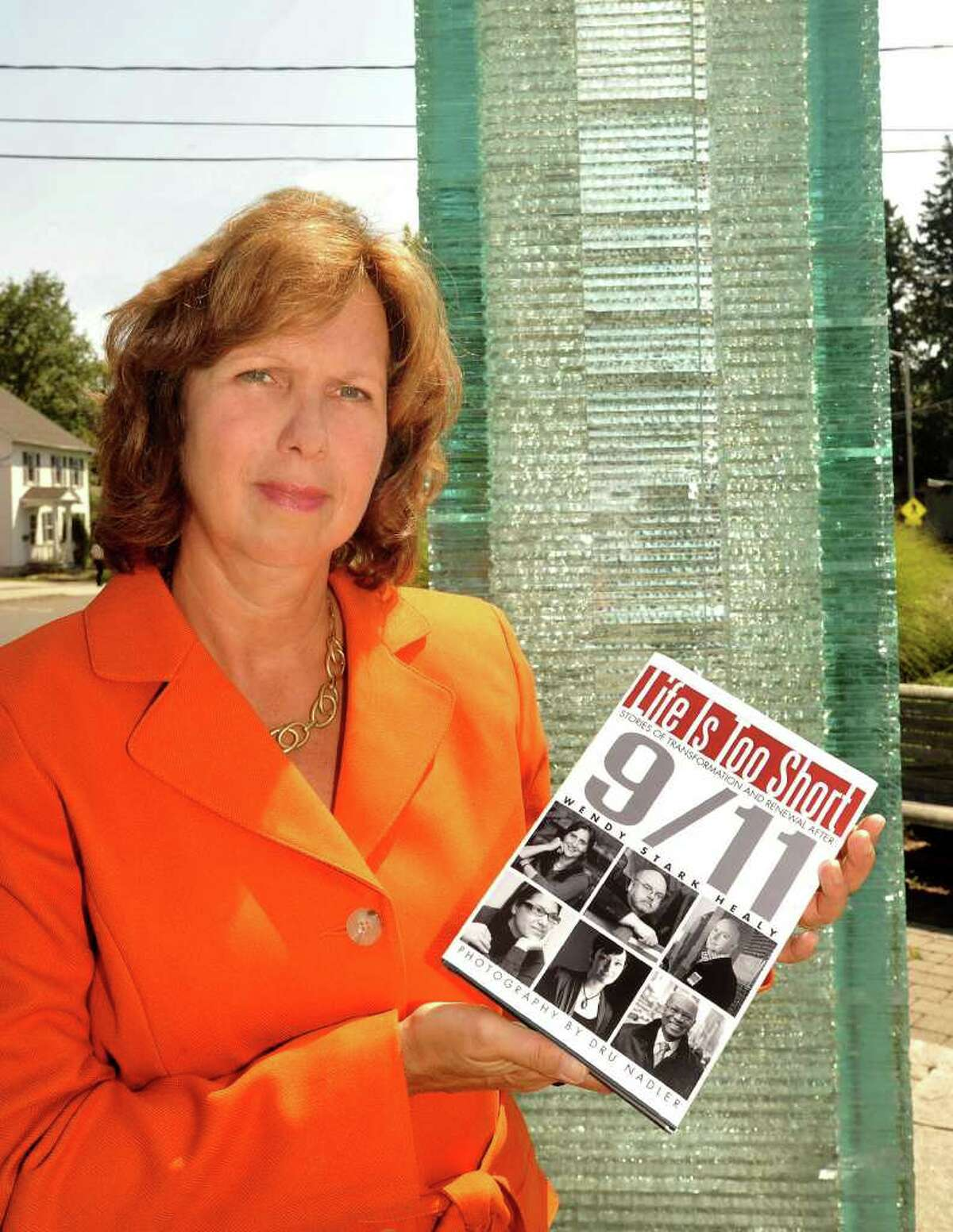 Wendy Healy holds her book